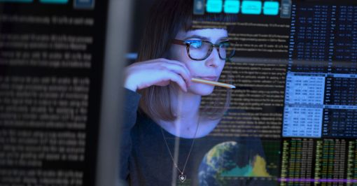 Woman reviewing code