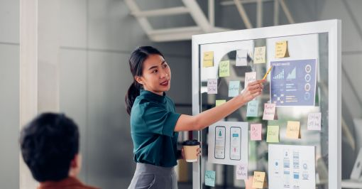 Woman working on kanban board