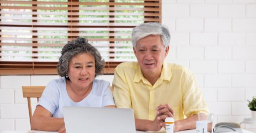 Mature couple participates in telehealth appointment