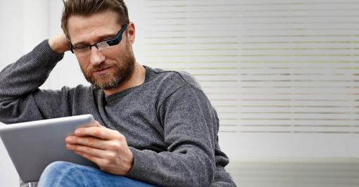 Man wearing high tech device on glasses.
